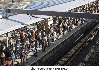 utrecht, netherlands, 15 march 2017: many travellers on platform of new central railway station in utrecht