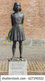 UTRECHT, NETHERLANDS - APRIL 09, 2017: Statue of Anne Frank holding flowers in Utrecht, Netherlands