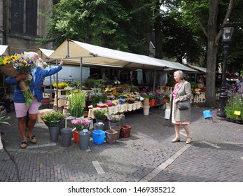 Utrecht, Netherlands - August, 03, 2019: Weekly flower market at st Janskerkhof in the center of Utrecht. This flower market is very popular by the locals.