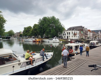 Utrecht, Netherlands - August, 03, 2019: Pleasure craft at a landing stage in the center of Utrecht. Before the Weerdsingel is a small harbor for pleasure craft.