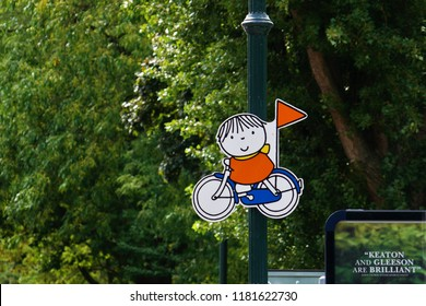 Utrecht, Netherlands - August 20, 2017: road sign depicting boy on the bicycle near Nijntje museum (Miffy museum)