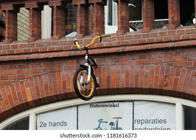 Utrecht, Netherlands - August 20, 2017:orange bicycle in the wall of bicycle shop