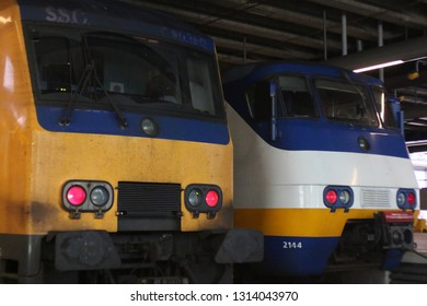 Utrecht, the Netherlands, February 15, 2019: Two types of trains from the dutch railway system nederlandse spoorwegen: the yellow intercity and white sprinter