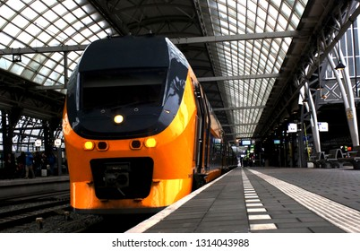 Utrecht, the Netherlands, February 15, 2019: The back view of a yellow train (intercity) from the ns