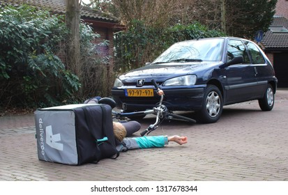 Utrecht, the Netherlands, February 19, 2019: car accident with deliveroo freelancer that might have insurance