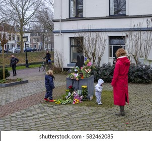 Utrecht, Netherlands, February 2017. Flowers and children at the statue of Miffy or Nijntje in Dutch after the death of her creator the artist Dick Bruna