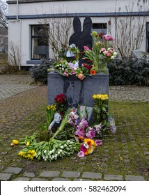 Utrecht, Netherlands, February 2017. Flowers at the statue of Miffy or Nijntje after the death of her creator, the artist Dick Bruna