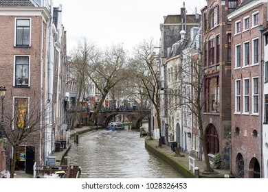 Utrecht, Netherlands - January 24, 2018: A typical Dutch view of the canals in Utrecht, with old warehouses on the sides. Utrecht is one of the busiest cities in the Netherlands.