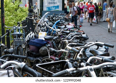Utrecht, Netherlands - July 2, 2015: Countless commuter bicycles lined up on city streets in the Netherlands