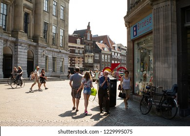 Utrecht, Netherlands - July 2, 2015: City scene in Holland with pedestrians, ancient buildings, and bustling city life