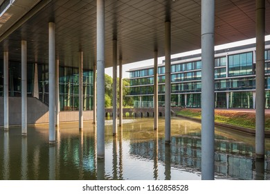 Utrecht, The Netherlands - july 24 2018: View of the monumental 'bridge with the twelve holes' between modern buildings at the headquarters of the Dutch Army. Part of the New Dutch Waterline.