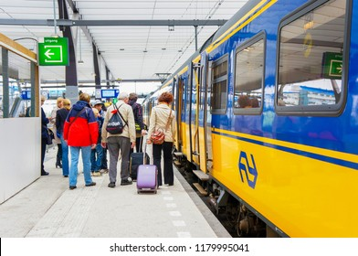 Utrecht, The Netherlands - June 2, 2012: People exiting a Nederlandse Spoorwegen train at the main station