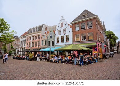 UTRECHT, THE NETHERLANDS, JUNE 2, 2018, Many people hanging out on terraces of bars in typical Dutch traditional buildings on a sunny spring day on a square in downtown Utrecht, 2 June 2018