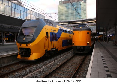 Utrecht, the Netherlands, March 8, 2019: Two yellow trains or intercities from the NS waiting to depart