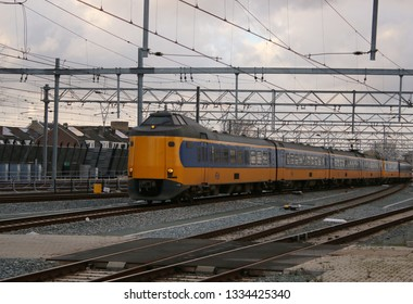 Utrecht, the Netherlands, March 8, 2019: yellow train or intercity from the ns and railway