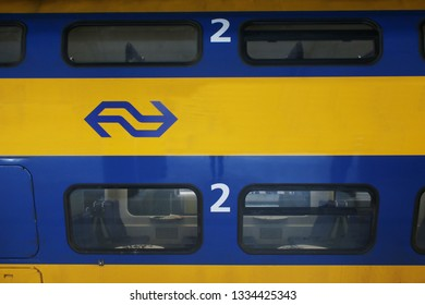 Utrecht, the Netherlands, March 8, 2019: close up of wagon from a yellow train called intercity of the NS