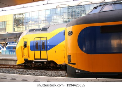 Utrecht, the Netherlands, March 8, 2019: Sideview of two yellow trains or intercities from the NS waiting to depart