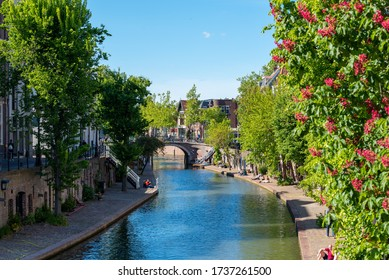 Utrecht / Netherlands - May 17, 2020: A sunny Sunday afternoon in Utrecht along the canal.