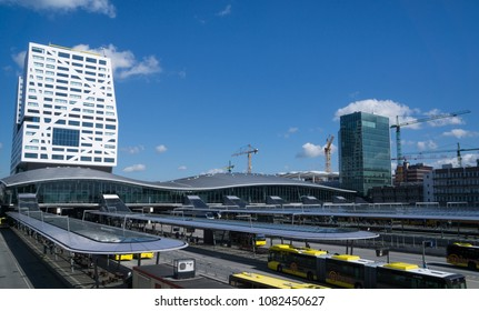 Utrecht, The Netherlands - May 2, 2018: Utrecht central bus and train station, Utrecht Centraal of the Dutch Railway system: Nederlandse Spoorwegen NS. Background: stadskantoor gemeente Utrecht.