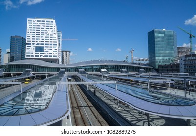 Utrecht, The Netherlands - May 2, 2018: Utrecht central train and bus station, Utrecht Centraal, Nederlandse Spoorwegen NS. Background: stadskantoor gemeente Utrecht municipality office town hall.