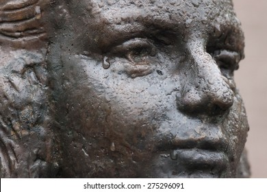 UTRECHT - THE NETHERLANDS, MAY 3, 2015: Detail of a public Anne Frank statue by P. 'd Hondt with raindrops on her face looking like tears on May 3, 2015 in Utrecht (Sint Janskerkhof), The Netherlands.