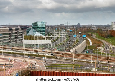 UTRECHT, THE NETHERLANDS; NOVEMBER 19, 2017: Thoroughfares and viaducts of Utrecht city with railway station Leidsche Rijn, the A2 Highway busy with traffic and many other roads under a cloudy sky.