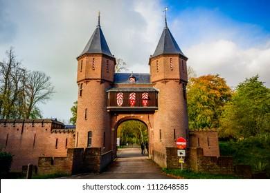 UTRECHT, THE NETHERLANDS - OCTOBER 29, 2017: The front entrance gate of De Haar Castle or Kasteel de Haar, the largest castle of Holland, near Amsterdam & Haarzuilens, Utrecht, Netherlands