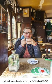 UTRECHT, NETHERLANDS, on March 30, 2016. The young woman has coffee in  cozy cafe