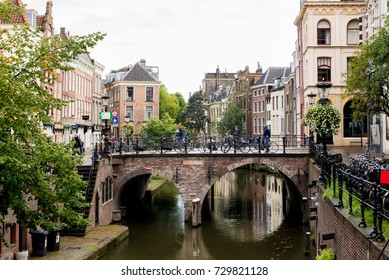Utrecht, Netherlands - September 2015: Medieval bridge on the Oudegracht (Old Canal) in central Utrecht, Netherlands with people cycling