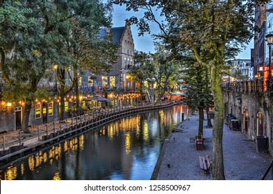 Utrecht, The Netherlands, September 30, 2017: a relatively quiet section of the Oude Gracht (Old Canal) with its characteristic two level quay with large trees on the lower quat