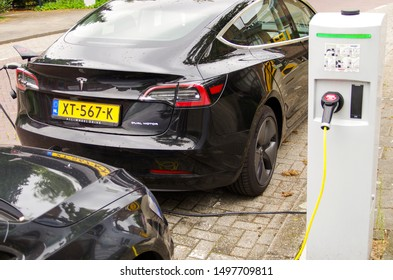 Utrecht, Netherlands - SEPTEMBER 6 2019: From 1 October 2019, electric cars (i.e. Tesla model 3) will no longer be able to park for free at a charging point in an area with paid parking in Utrecht.