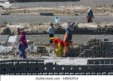 UTTAR PRADESH, INDIA- MAR 2: labourers prepare bricks at a brick kiln on March 2, 2013, in Uttar Pradesh, India. The Indian brick industry is the second largest in the world after China.