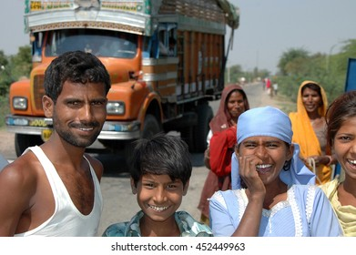 UTTAR PRADESH, INDIA - MARCH 05, 2006: Group of curious children and adults on a road of Indian