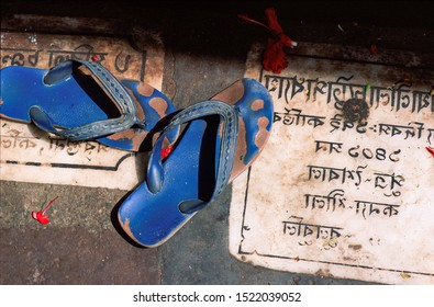 Uttar Pradesh/India - 11/30/1998: ancient stone transcriptions in Sanskrit language at the entrance of an Indian Hindu temple. In the traditional manner shoes are left outside.