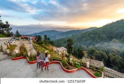 Uttarakhand, India, October 19,2018: Tourists enjoy sunrise view from hotel terrace with view of Himalaya range at Kausani Uttarakhand India.