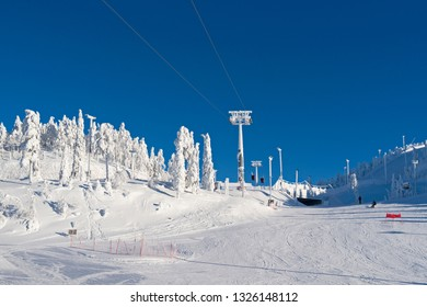 uusamo / Finland: Gondola lift over the downhill ski slopes in Ruka village on a beautiful and sunny day in February