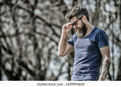 UV filter. Bearded hipster brutal man wear protective sunglasses. Man bearded with sunglasses nature background. Hipster confident in dark sunglasses. Bearded man wear modern fashionable sunglasses.
