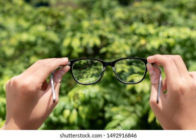 uv protection sunglasses for short or long sight On the boy's two hand ,Concept Problems with blurred vision caused by short cables or visual abnormalities.selective focus and have copy space