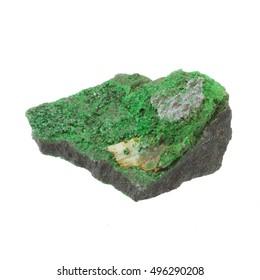 Uvarovite crystal rough specimen on matrix on white background