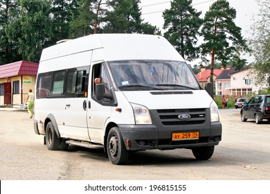 UVILDY, RUSSIA - JULY 26, 2008: White Ford Transit passenger van at the interurban road.