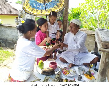 uwelolu, Indonesia - January 2020. Balinese traditional ceremony Mebayuh. a child who is ceremonially cleansed of vices