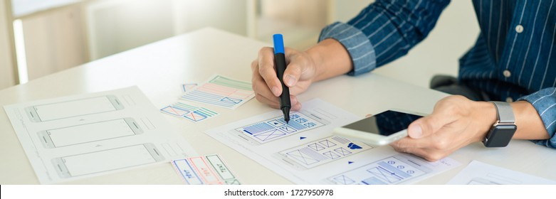 ux designer creative planning application development near layouts of mobile smartphone frameworks, User experience concept
