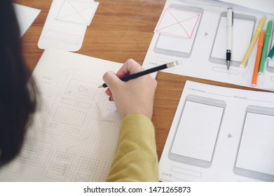 Ux designer drawing layout interface graphic planning application development for web mobilephone.
