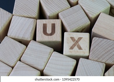 UX, User Experience design concept, cube wooden block combine abbreviation UX, development of a journey and interaction between product or service and customer or consumer.