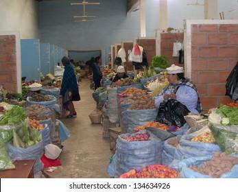 UYUNI, BOLIVIA - AUGUST, 12: Uyuni, Bolivia -  indigenous women shopping in a vegetable market.  August 12, 2004