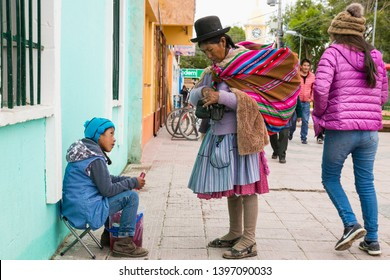 Uyuni, Bolivia - Dec 31, 2018:   Woman in traditional costume on the market in main street of Uyuni,  Bolivia.