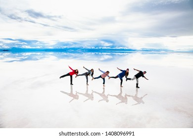 Uyuni, Bolivia- Dec 31, 2018: Group of people make figures with their bodies on the lake Salar de Uyuni, Bolivia. America