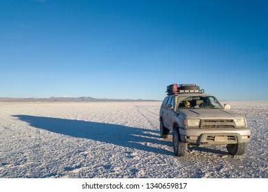 Uyuni, Bolivia, Jan 2019 - 4x4 SUV in Uyuni Salt Flat in Bolvia.