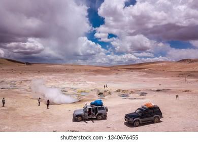 Uyuni, Bolivia, Jan 2019 - Tourists Visit Sol de Mañana Geysers, in 4x4 Vehicles. Uyuni, Bolivia - Aerial Drone View