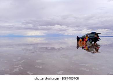 UYUNI, BOLIVIA, JANUARY 31, 2018: Tourists having lunch at the famous salt lake flat of Uyuni, mass tourism, Uyuni, Bolivia, South America